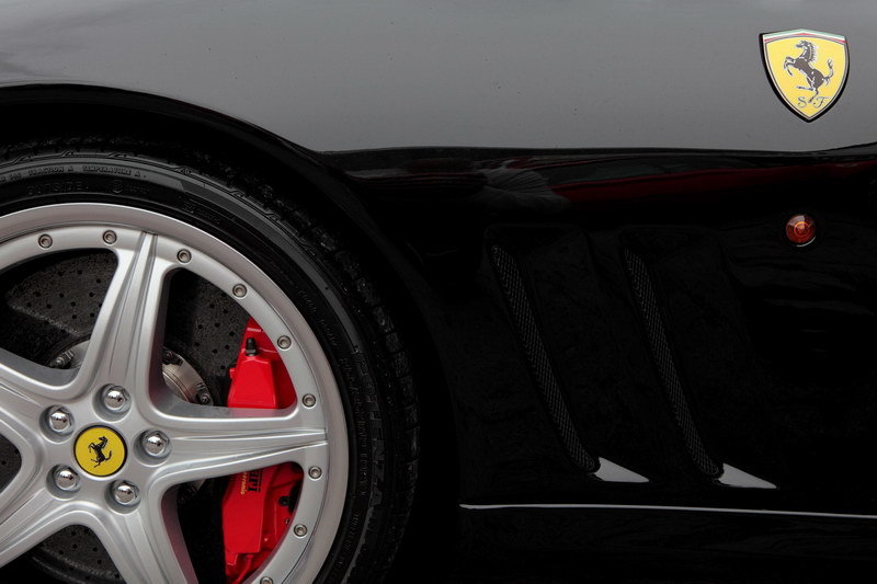 Wheel and black bodywork of Porsche Car