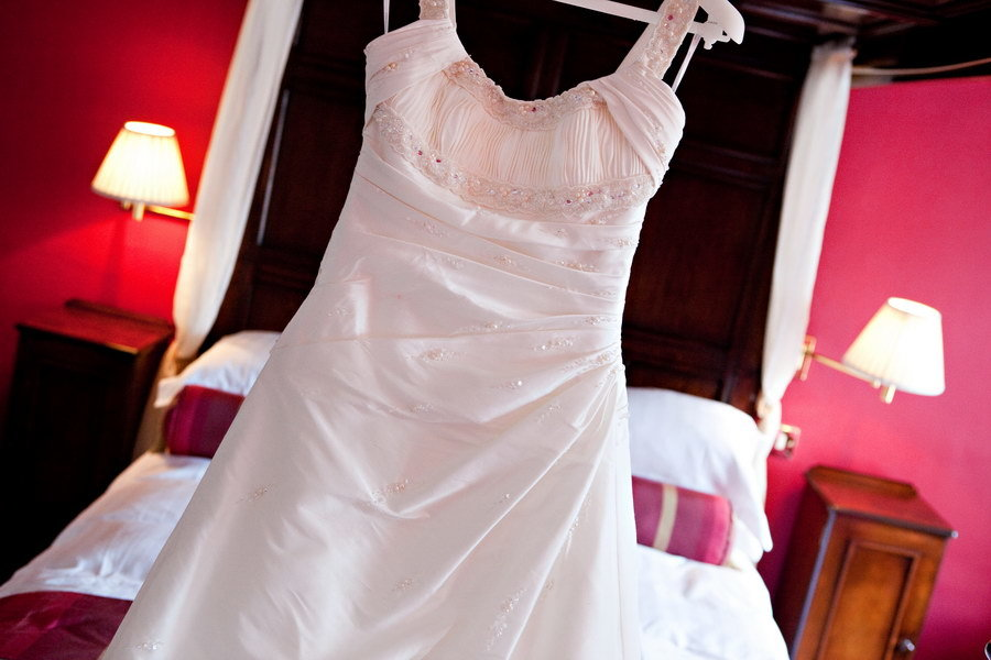 Dress Hanging Up on the Morning of the Wedding
