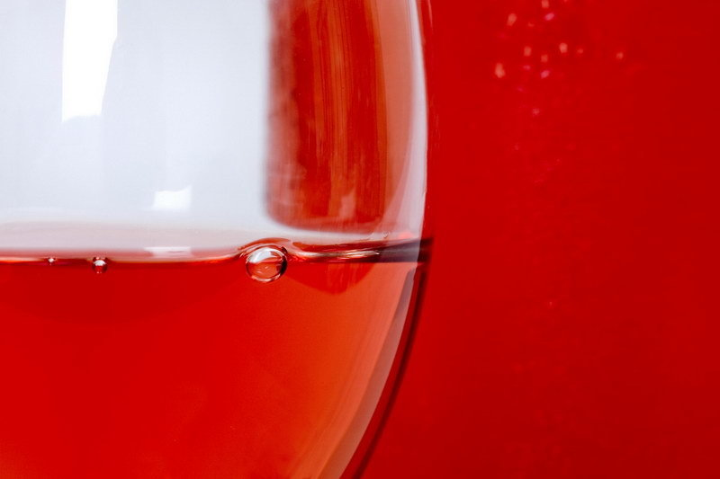 Close up of rose wine in glass with bubble