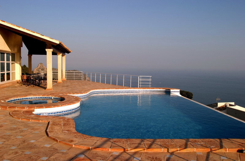 Luxury infinity swimming pool in villa in spain with incredible